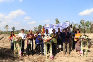 Lane Xang Minerals Limited Sepon hands expanded rice paddies to villagers next to Sepon Mine.